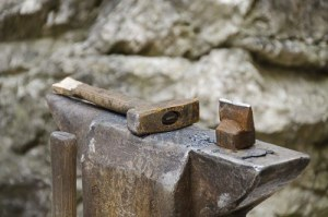5584483-a-view-at-the-blacksmith-workshop-a-blacksmith-s-hammer-on-the-top-of-the-anvil-photo-taken-on-the-9